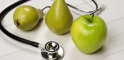 Healthy fruit with stethoscope to indicate wellness programs